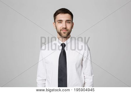 Business Concept - Young successful businessman posing over dark background. Copy space.