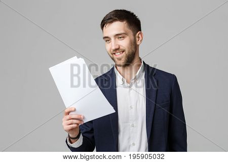 Business Concept - Portrait Handsome Business man happy working with annual report. White Background. Copy Space.