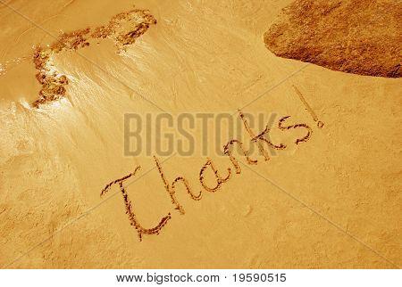 Thanks! handwritten in sand on a beach