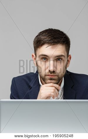 Business Concept - Portrait handsome stressful business man in suit shock looking at work in laptop. White Background.