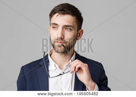 Business Concept - Portrait of a handsome businessman in suit with glasses serious thinking with stressful facial expression. Isolated White background. Copy Space.