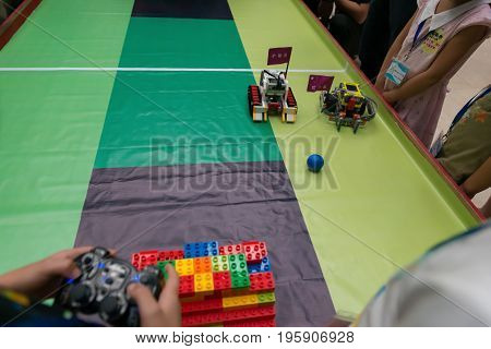 Zhongshan China July 16;2017: Kids controlling robots in a robot football match on July 16;2017.