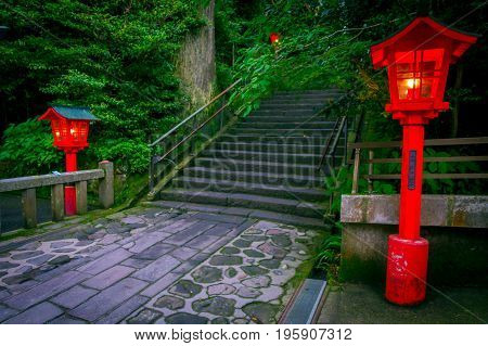 The night view of the approach to the Hakone shrine in a cedar forest. With many red lantern lighted up.