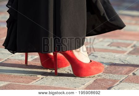 Legs of a girl in red hairpins