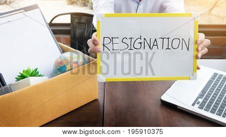 Businessman Resignation Packing Up All His Personal Belongings And Files Into A Brown Cardboard Box