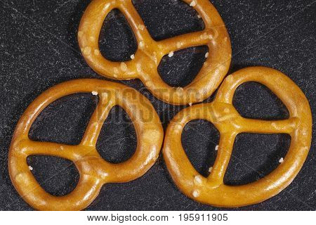 closeup of some lye pretzels in dark back