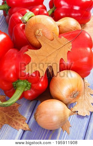 Fresh Onions, Peppers And Autumnal Leaves On Purple Boards, Healthy Diet, Nutrition And Seasonal Con
