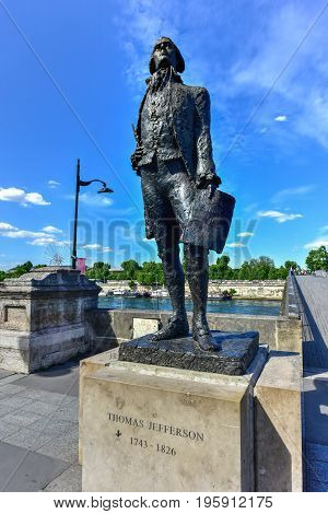 Paris, France - May 16, 2017: Bronze statue of Thomas Jefferson near the Jardin des Tuileries garden and the Pont Solferino in Paris.