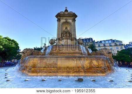 Paris, France - May 16, 2017: The Fountain Saint-Sulpice or Fountain of the Four Bishops built in the center of Place Saint Sulpice between 1844 and 1848 in Paris France.
