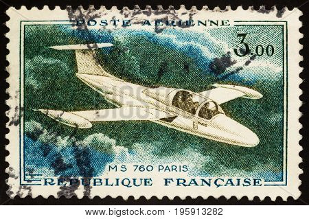 Moscow Russia - July 19 2017: A stamp printed in France shows aircraft MS 760 Paris - French four-seat jet trainer and liaison aircraft by Morane-Saulnier (1954) circa 1960