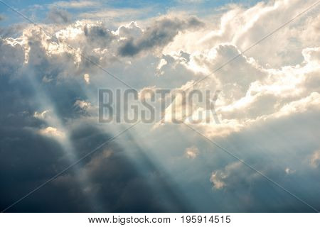 Dramatic and beautiful storm clouds with heavenly sun rays.