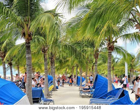 Grand Turk Island in the Turks and Caicos - March 10 2017- Cruise ship passengers relaxing on the beach on Grand Turk Island