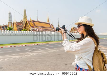 Young Asian Woman Photographer Taking Picture