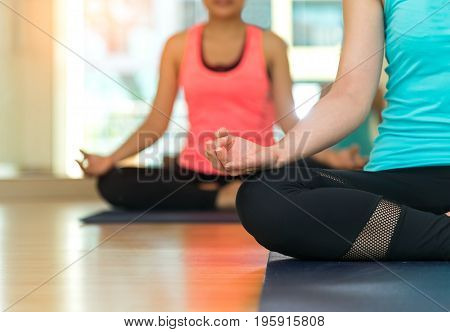 Asia people practicing and exercising vital meditate yoga in class. Healthy Concept