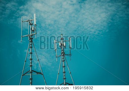 Antennas Of Cellular And Communication Systems With The Blue Sky, Vintage Tone With Vignetting.