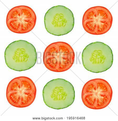 pieces of tomatoes and cucumber on a white background slice cucumber ans tomato on white