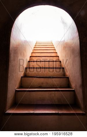 Light at the end of old staircase