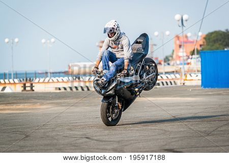 VLADIVOSTOK, RUSSIA - October 05, 2013: Stunt motorcycle rider performing at a local motorcycle show.
