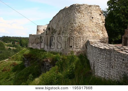 Wall and part of a tower of a fortress in Izborsk. All is made of limestone.
