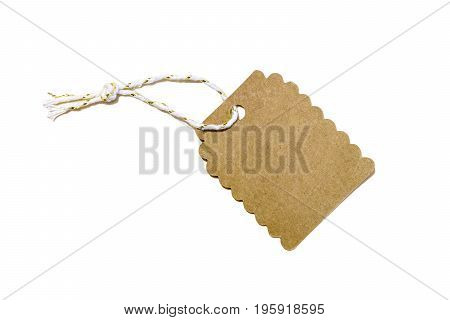 Blank decorative cardboard paper gift tag with twisted string tie isolated on white
