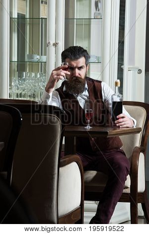 Hipster Waiting With Bottle At Table Served For Two