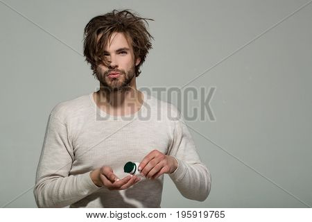 Man With Pill In Plastic Jar