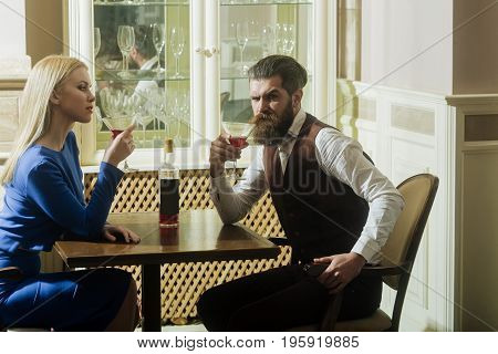 Woman And Man Drinking From Martini Glasses