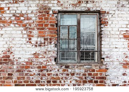 Wooden Window On Weathered Red Brick Wall Painted White