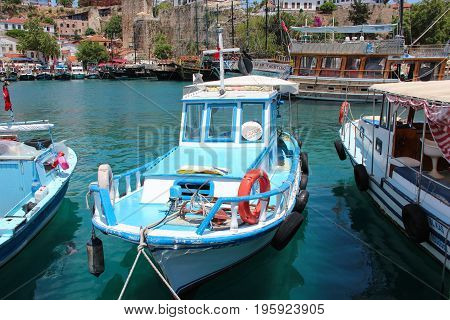 Antalya, Turkey - May 29 2017: View of an small blue fishing boat in the Harbor of the famous resort city.