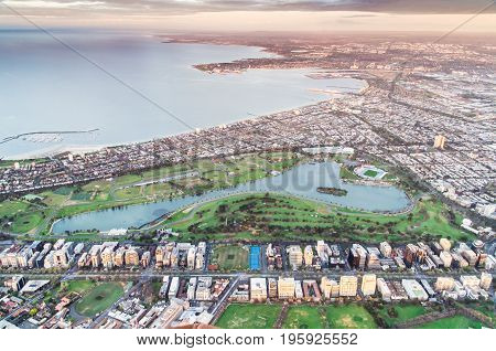 Melbourne bayside suburbs of Albert Park and South Melbourne with Albert Park Lake in the foreground in Australia.