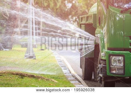 Water Truck Spraying Water To Landscape In The Public Park In Phuket