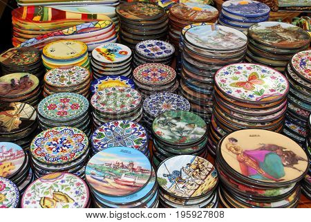 TORREMOLINOS, SPAIN - SEPTEMBER 3, 2008 - Pretty ceramic plates for sale at an old town shop Torremolinos Malaga Province Andalusia Spain Western Europe, September 3, 2008.