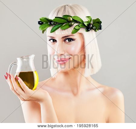 Beautiful Healthy Woman on Background with Copy Space. Cute Girl with Olive Oil Diet and Healthy Eating Concept