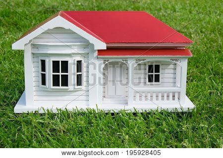 Bungalow villa house model in Australian or New Zealand NZ victorian style on lawn grass - front view