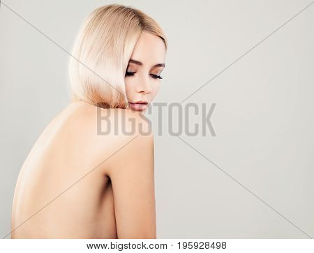 Perfect Healthy Woman on Background with Copy Space Female Back. Spa Beauty Facial Treatment and Cosmetology Concept