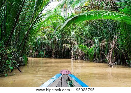 Traditional canoes on a canal in Can Tho province in the Mekong Delta in Vietnam.