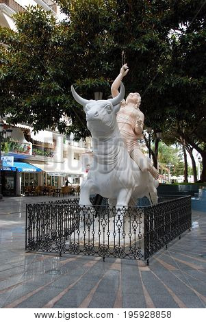 TORREMOLINOS, SPAIN - SEPTEMBER 3, 2008 - Monument to Europe statue featuring a woman sitting on a bull Torremolinos Malaga Province Andalusia Spain Western Europe,September 3, 2008.