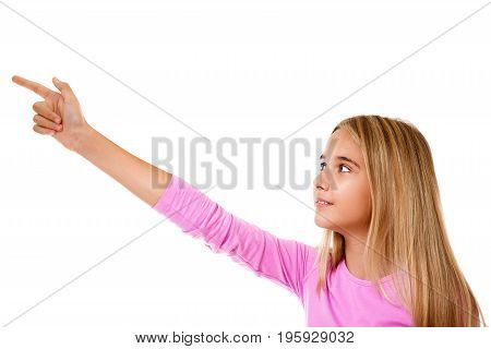 Attractive young girl pointing her finger. White background