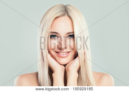 Blonde Model Woman with Healthy Skin and Blonde Hairstyle. Cute Female Face. Spa Beauty Facial Treatment and Cosmetology Concept