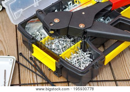 Rivet Tool And Rivets Of Various Sizes In The Storage Box