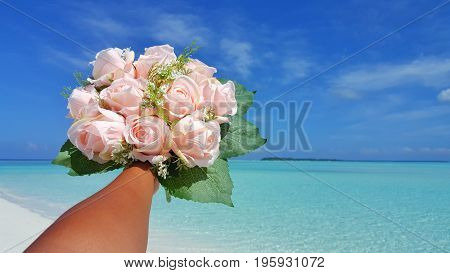 Maldives white sandy beach pink bouquet flowers on sunny tropical paradise island with aqua blue sky sea ocean 4k
