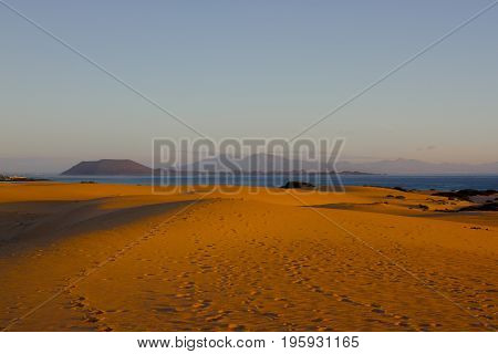 Bright sand and sky at Atlantic ocean background. Sahara dunes, beauty background.