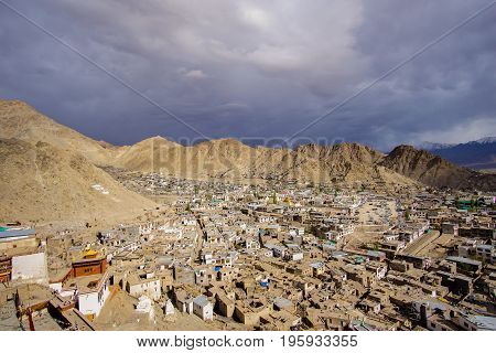 Leh Ladakh city view from Leh palace.  Beautiful amazing village in the valley with snow mountain at background.   Ladakh, India.