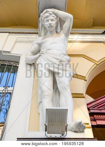 Odessa, Ukraine - July 15, 2016: Sculpture on former Valtuh apartment building, Odessa Ukraine.