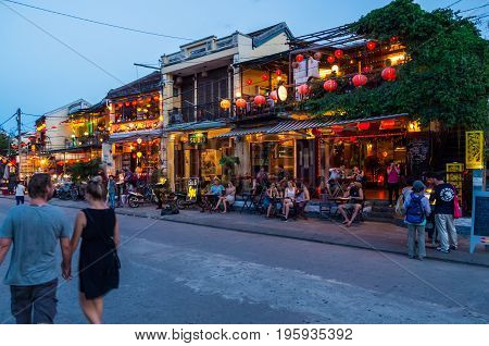 Hoi An, Vietnam - August 14, 2015: restaurants and shops on the banks of the Thu Bon river on Nguyen Phuc Chu in Hoi An at night.