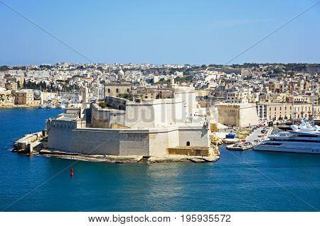 View towards Vittoriosa and Fort St Angelo seen from Valletta Valletta Malta Europe.