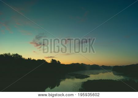 Morning sky at dawn with rare clouds over the river Hoper in the city of Balashov.