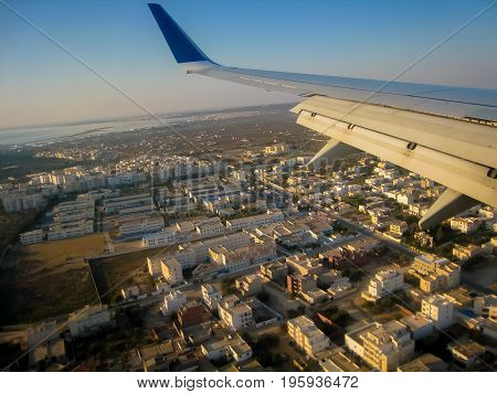 Landing of passenger aircraft in Dubai UAE, view of the city and the Persian Gulf from a flight altitude