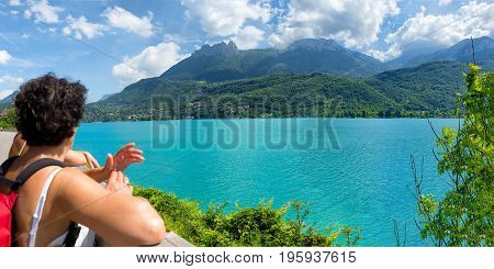 a hiker woman watching view of Lake Annecy