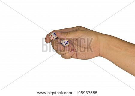 Man's Hand Squeezes Two Dice Isolated On White Background